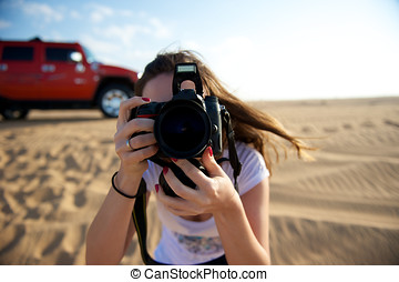 Photography - Pretty young woman taking photo in the Dubai...