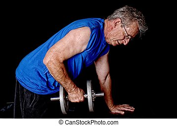 Senior Exercising - Senior man weight traing and exercising...
