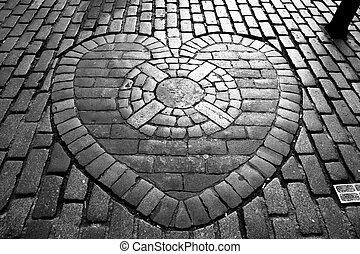 The Heart of Midlothian, built into the cobblestones of...