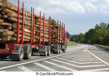 timber truck on the move - large timber truck driving on...
