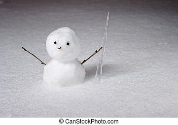 Little snowman with icicle in the night