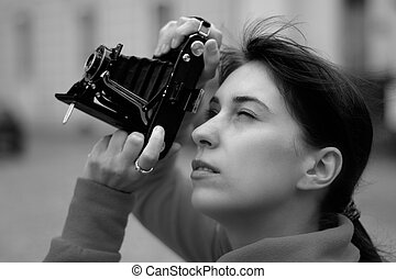 Female photographer with old camera