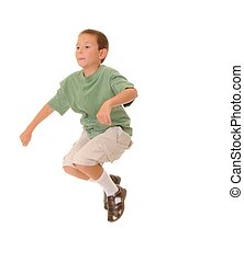 Jumping Boy - A Young boy jumping isolated over white
