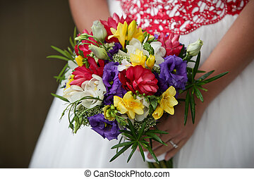 Wedding Flowers - Wedding flowers being held by bride