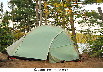 Tent at Campsite in the Wilderness by a Remote Lake in...