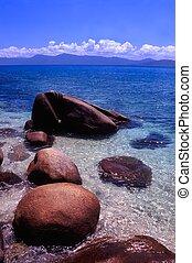 Fitzroy Island - Australia - Light waves wash in among huge...