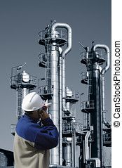 chemical worker and oil refinery - chemical worker pointing...