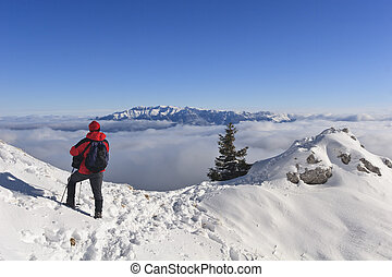 mountain climber - a mountain climber who looks over clouds