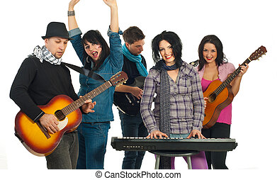 Cheerful band of five people playing musical instruments and...