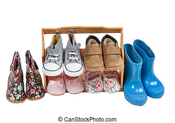 Shelf of children shoes for all seasons isolated on white -...