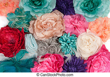 A field of artificial flowers (ladies barrettes with...