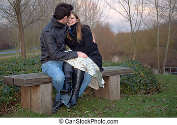 quality time together - young couple sitting together in a...