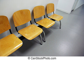 waiting room - Waiting room of a clinic with a row of empty...