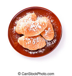 Croissants on a brown plate isolated on a white background