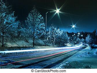 Winter street traffic - Small town street traffic on dark...