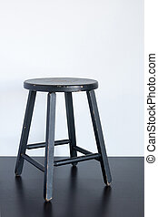 Black shabby stool on wooden surface - Painted black shabby...