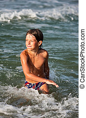 swimming boy - people series: swimming boy on sea beach