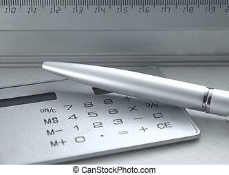 Tools for calculation; the metal handle, calculator, ruler