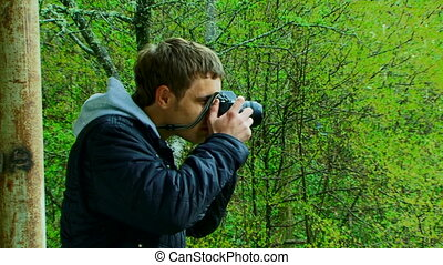 Professional photographer - A young man with a camera...