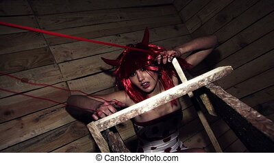 Demon cornered - A beautiful young girl dressed as devils...