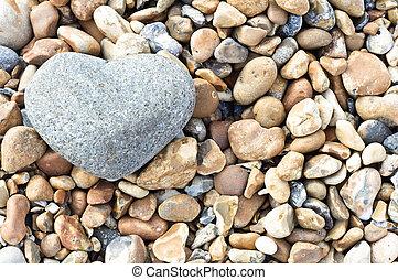 Heart Stone - Landscape Orientation - A grey heart shaped...