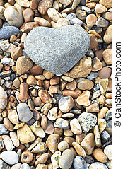 Heart Stone - Portrait Orientation - A grey heart shaped...