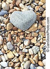 Heart Stone - Portrait Orientation - A grey heart shaped...