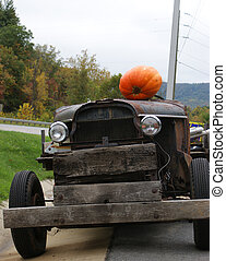 The Jalopy - An old car with a pumpkin headed driver.