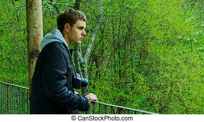 Photographing nature - A young man with a camera...