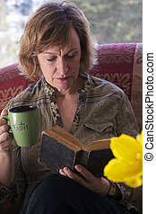 Baby boomer Mum taking a break and reading a book - Baby...