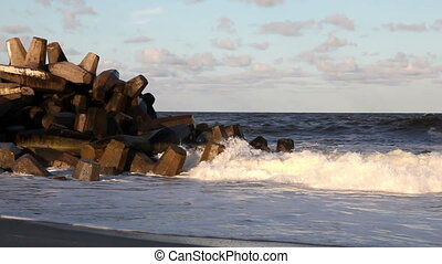 Waves Crashing onto Jetty in Ocean