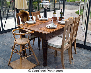 Cozy conservatory with tables and chairs - Cozy rustic style...