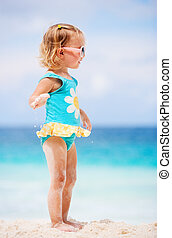 Toddler girl at beach - Adorable toddler girl in blue and...