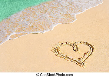 Drawing heart on beach