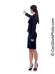 Business woman points finger at something in her back...
