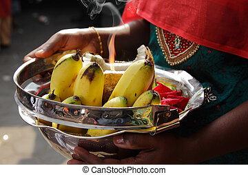 Bowl of offerings - A woman holding a bowl of offerings...