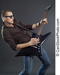 Guitar player with sunglasses