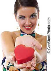 woman holding a big red heart