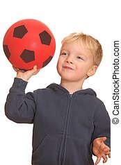 Boy throws a ball - Portrait of a young boy throwing a red...
