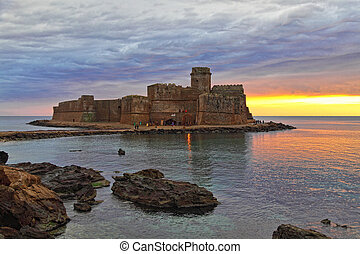le castella castle at sunset ruin in italy