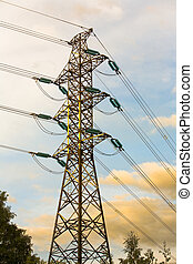 Electricity Pylon - Electricity pylon with clouds and trees...