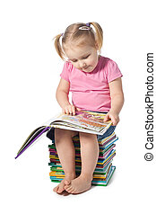 small child reading a book - a small child reading a book