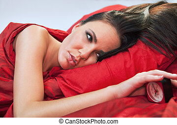 wake up - Pretty young woman in deb waken up by her alarm...