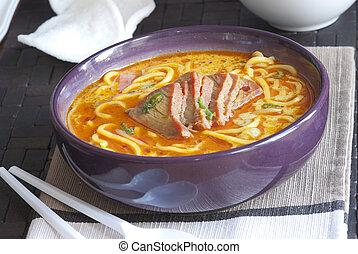 Meat and noodle soup - Singapore laksa noodle soup in a bowl