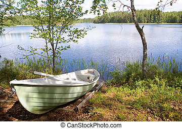 Rowboat stranded ashore at a lake in Finland