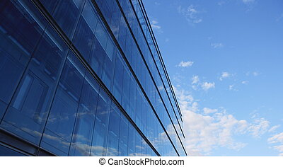 Office Building - Glass wall of an office building,...