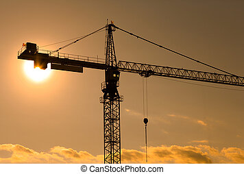 Construction Crane - Sun behind a crane at a construction...