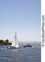 Sailboat vs Motorboat - Sailboat and motorboat very close of...
