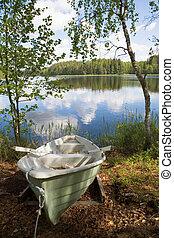 Rowboat stranded ashore at a lake in Finland