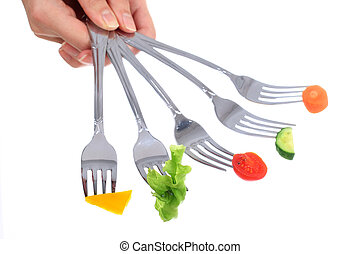 Vegetables on forks. - Vegetables on forks isolated over...